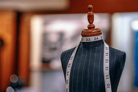 Tailor's mannequin with tape measure