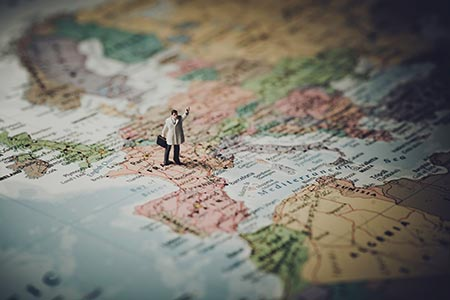 Man standing on a map like a freelance translator hoping to be found