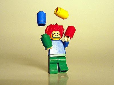 Lego figure juggling translation and family life