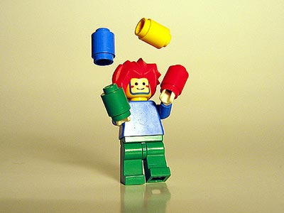 Lego figure juggling translation and family life